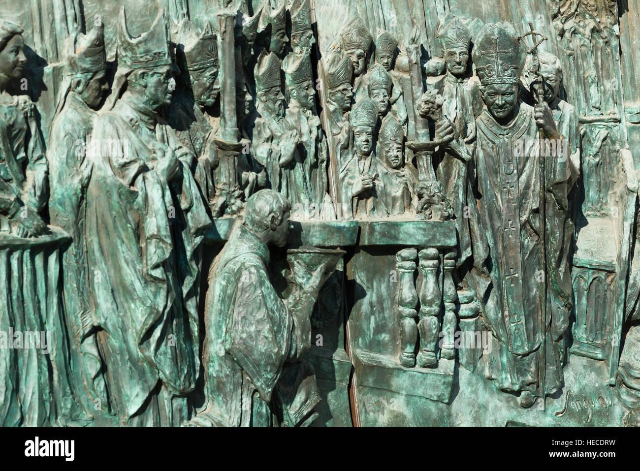 Almudena Cathedral, Santa María la Real de La Almudena. Detail of bronze doors at entrance. Madrid, Spain - Stock Image