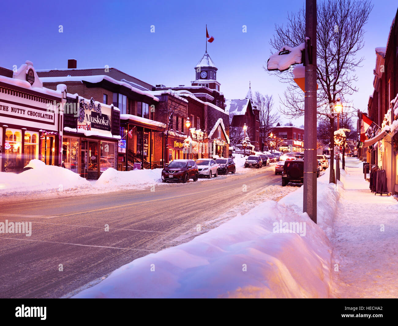Snowy winter scenery of a Canadian town Huntsville before Christmas, shops on Main street, town center, Muskoka, - Stock Image