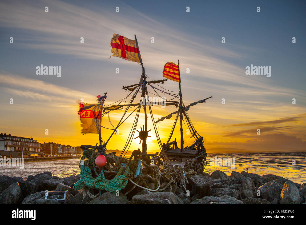 Hoylake, The Wirral, UK. UK Weather. Strong winds on the west coast as the flags of the driftwood Pirate ship signal Stock Photo