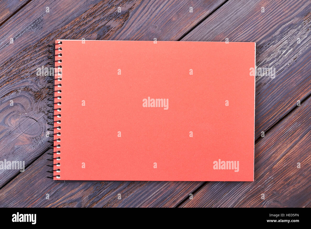 Notepad on wooden background. - Stock Image