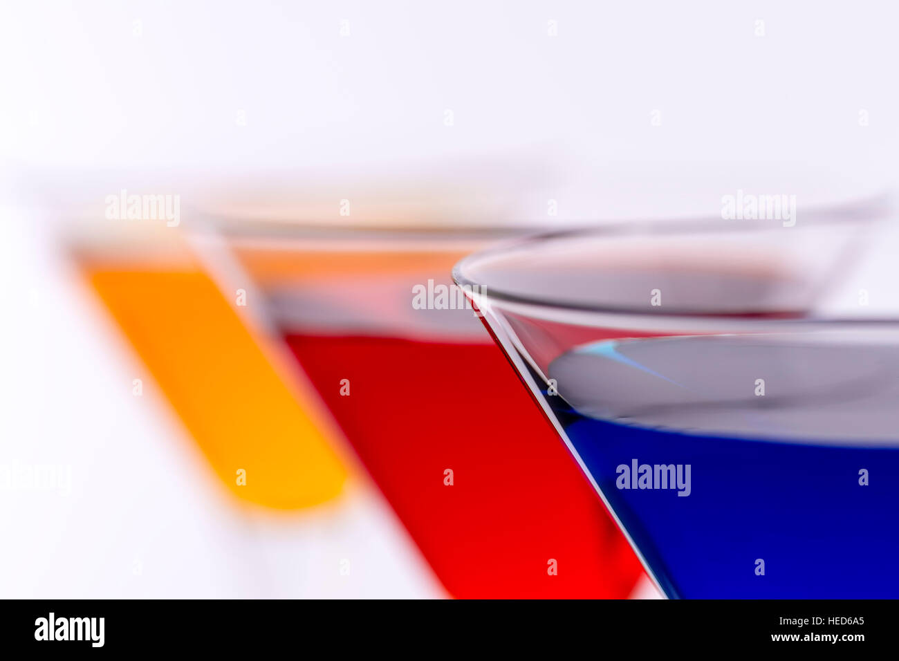 Colorful Cocktails in Martini Glasses Background. Bar Commercials Concept. Stock Photo