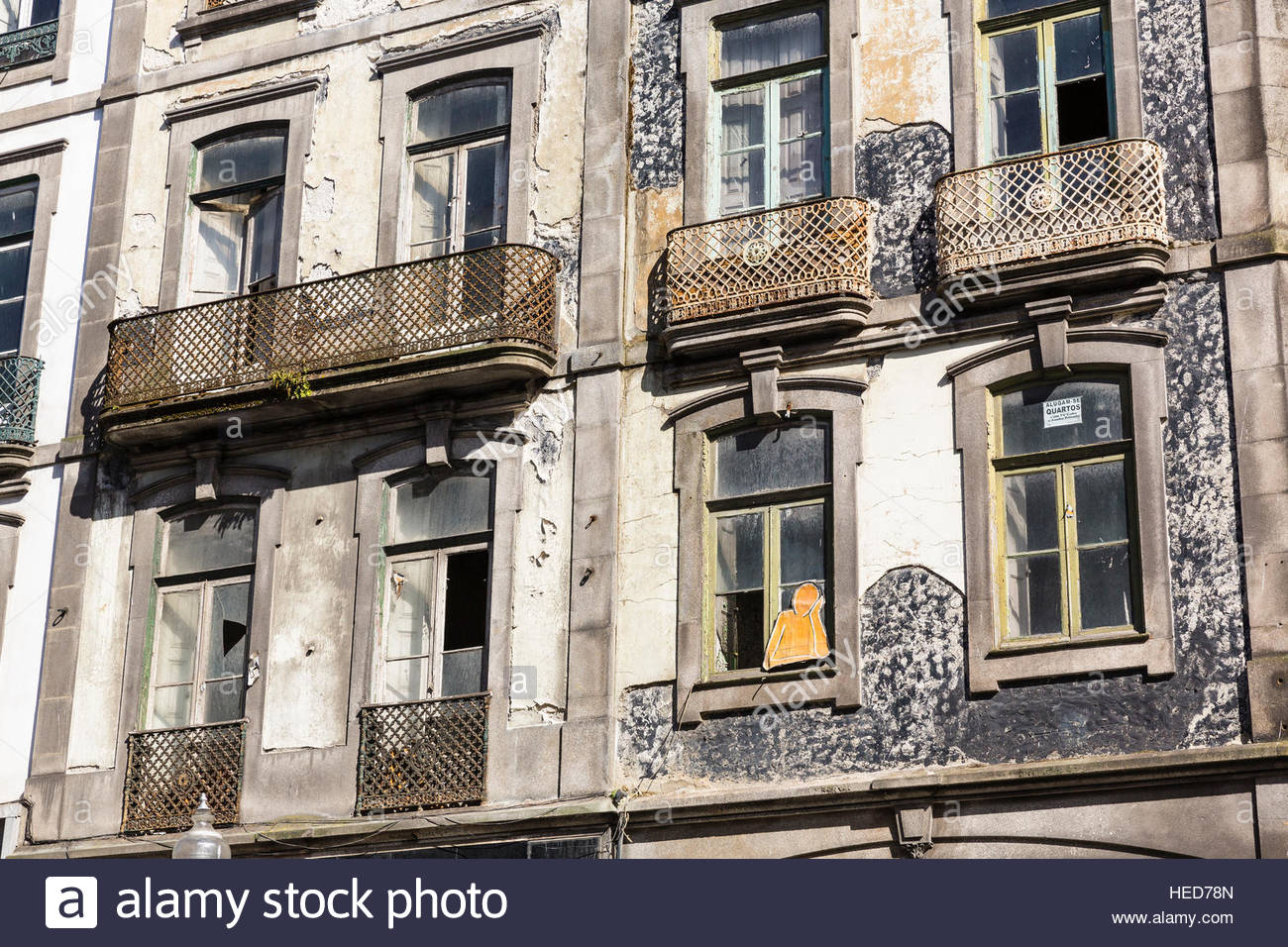 building,fassade,figure,humour,old,posture,ramshackle,residental,rundown,tourism,travel destination,UNESCO World - Stock Image