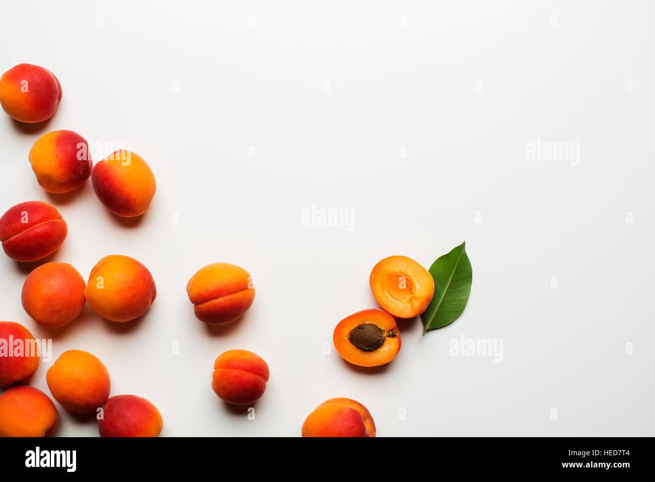 Fresh cut apricot fruits on white background - Stock Image