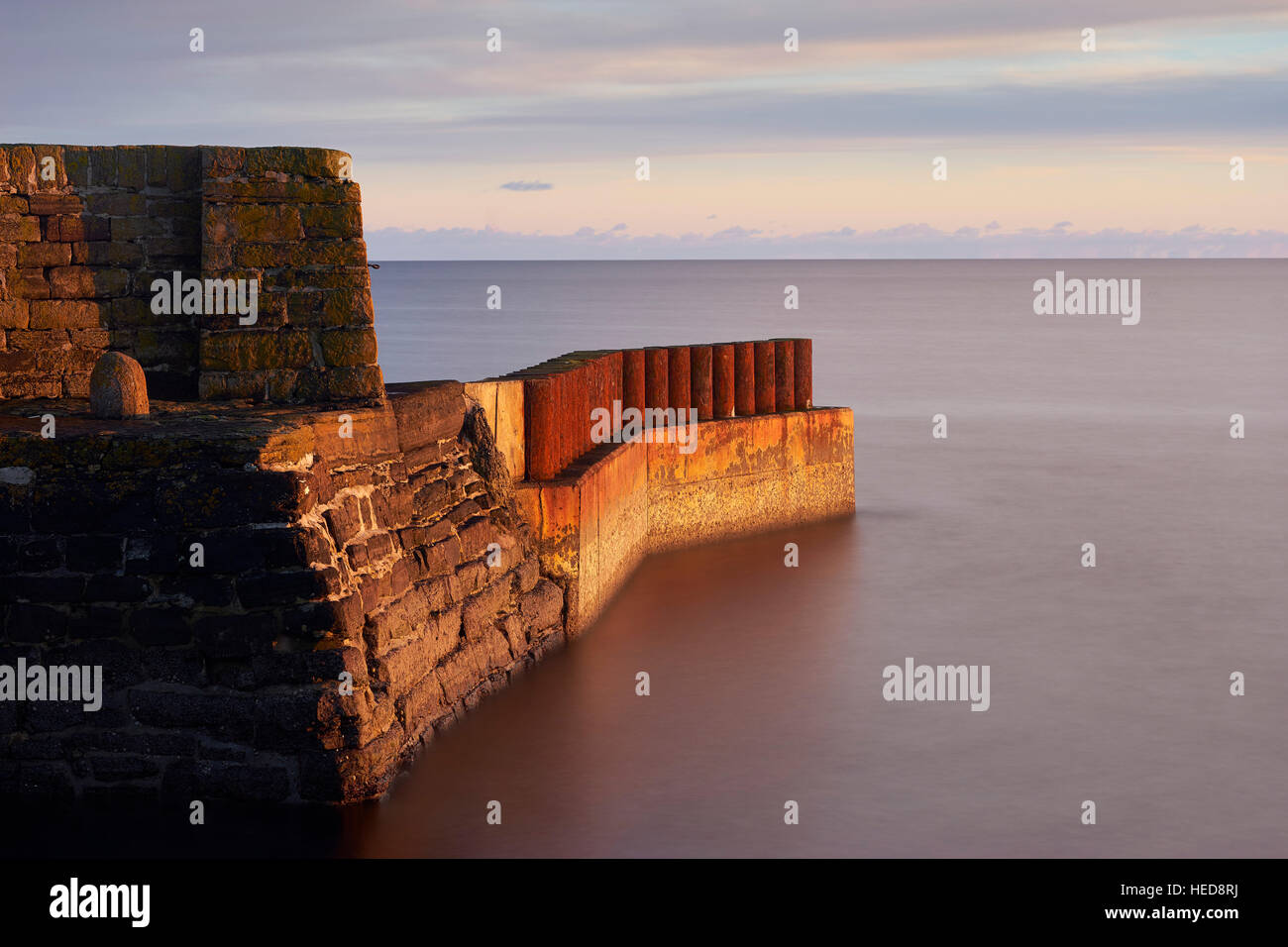 Keiss Harbour at sunset, Caithness, Scotland - Stock Image