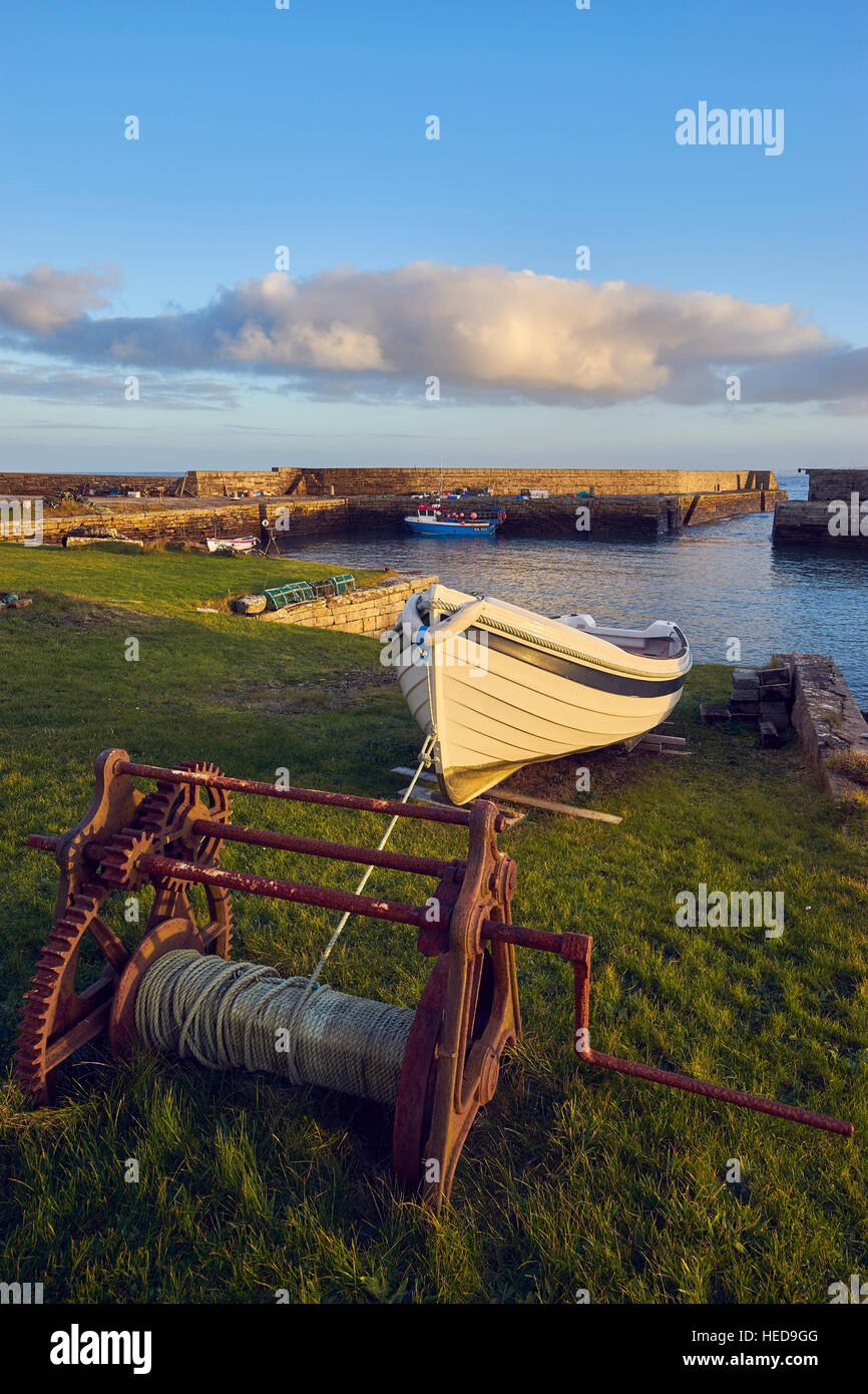 Sandside harbour, near Reay, Caithness, Scotland.  With winch and small boat. - Stock Image