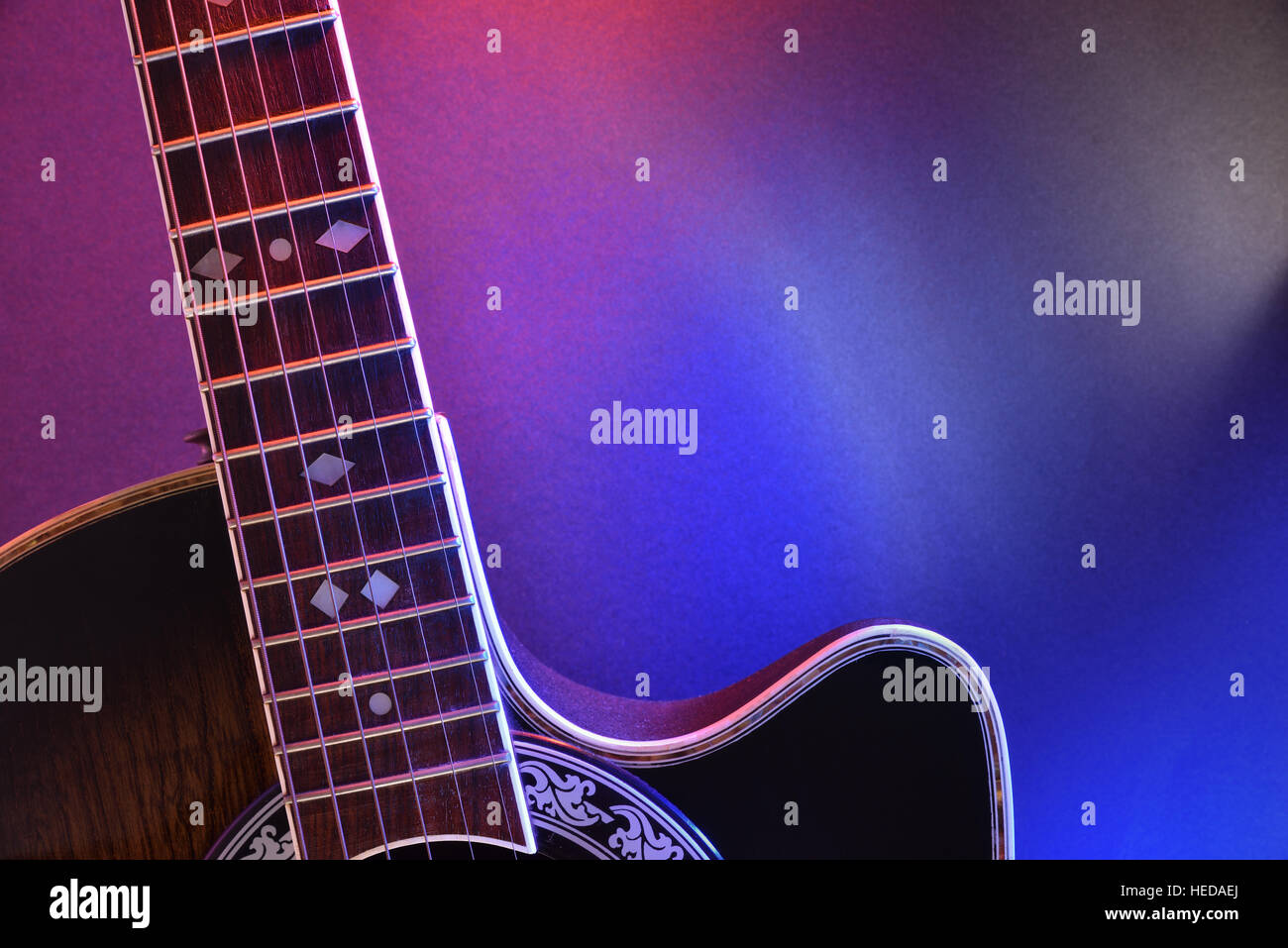Acoustic guitar and isolated with red and blue lights  Top