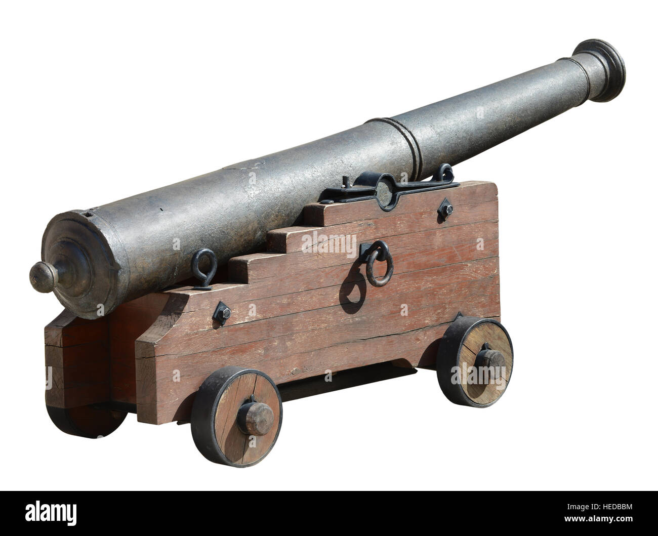 Ancient medieval cannon on wheels, isolated on white. - Stock Image