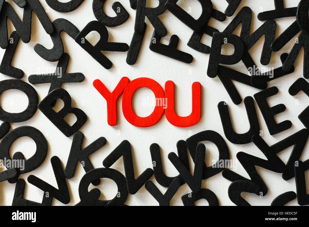 Red letters spelling the word you to illustrate the concept of the self and personal identity. - Stock Image