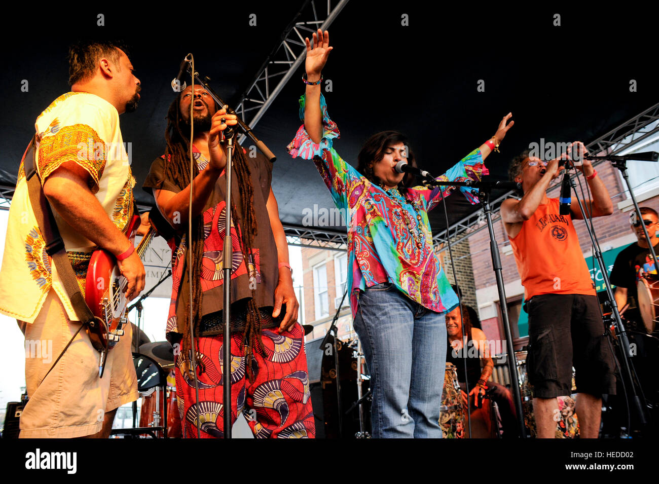 Chicago musical group, Funkadesi, playing at local neighborhood festival. - Stock Image