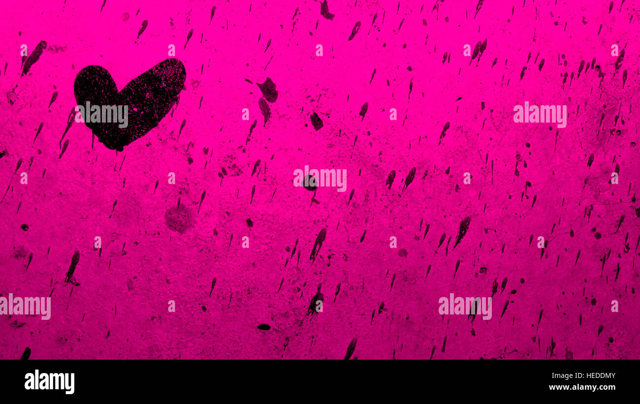 Black Heart Painted On Pink Backdrop With Paint Splatters