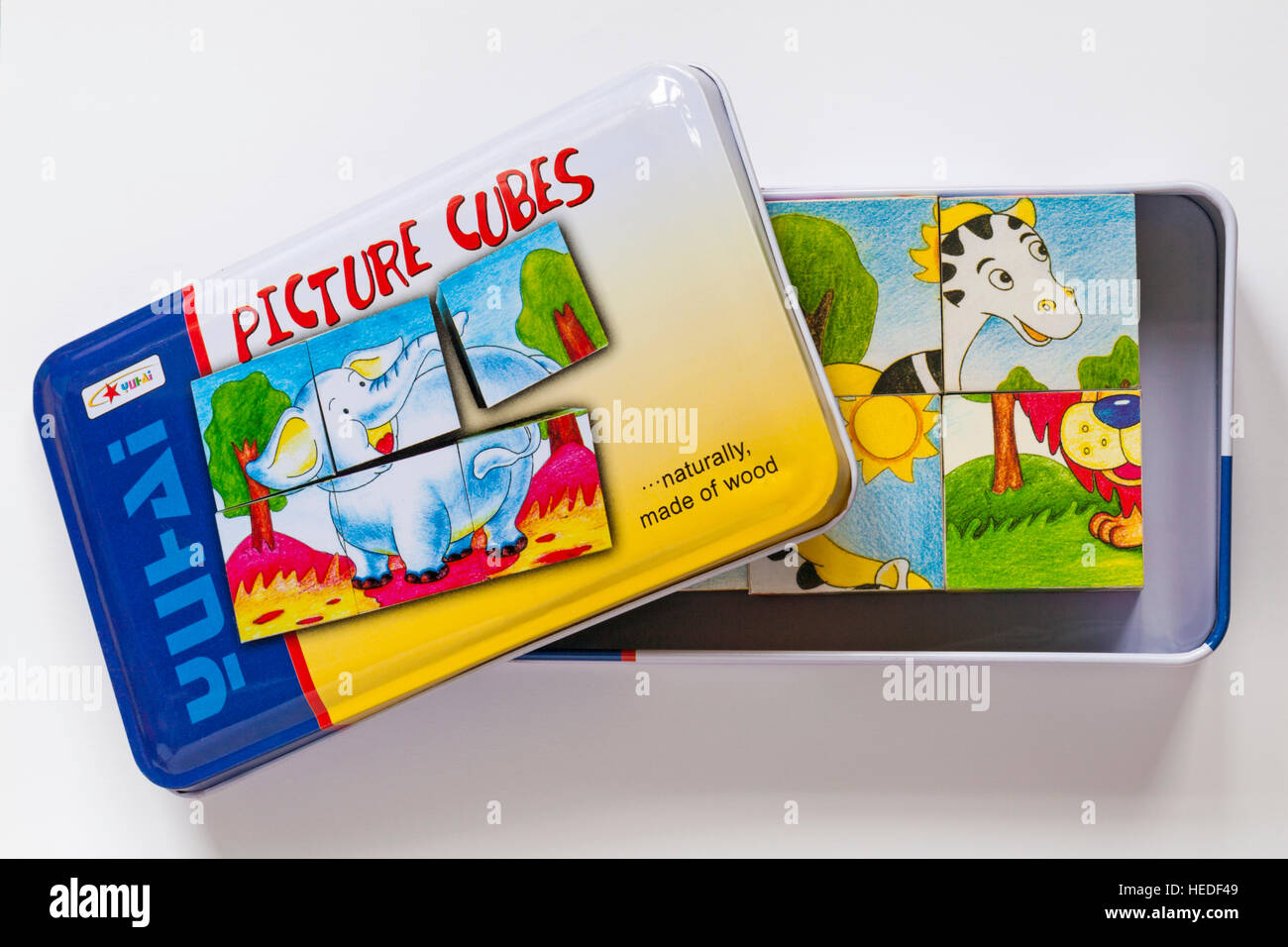 Yutai 6 six animal picture cubes inside a metal tin. Six different puzzles can be made with the cubes - Stock Image