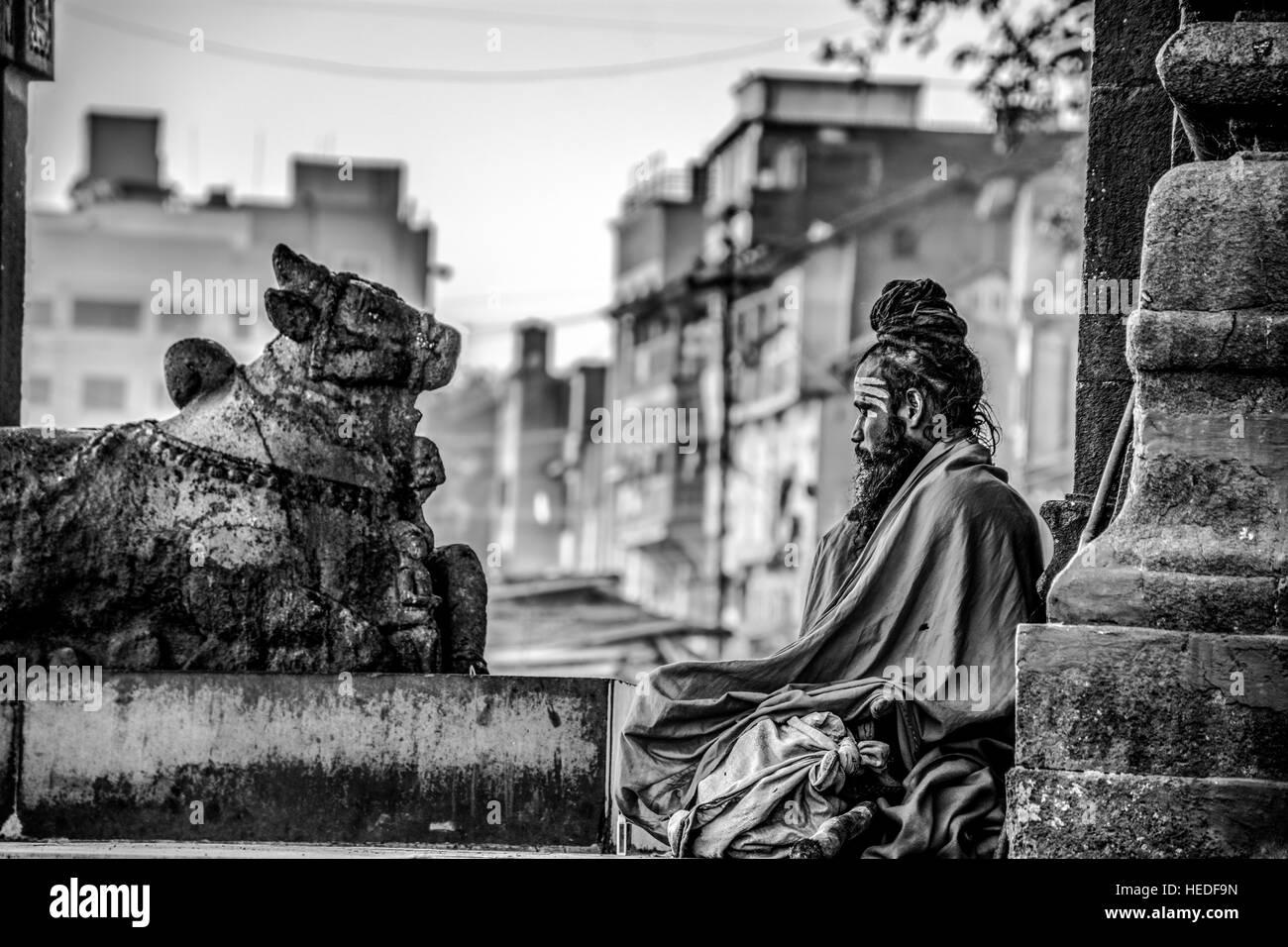 A sadhu peacefully doing his meditation. - Stock Image