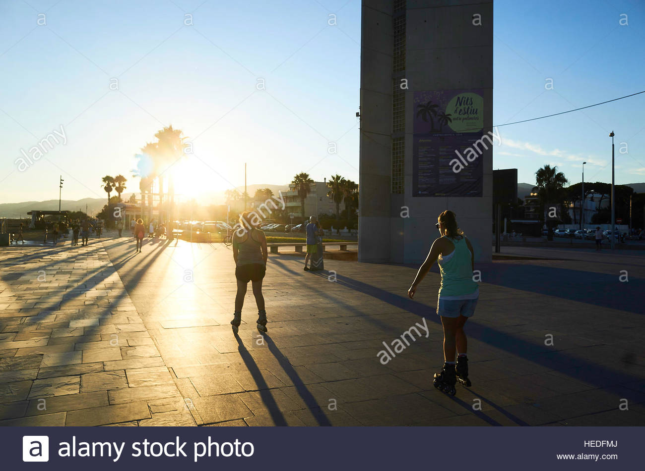 Roller skaters in sillouette at Platja de Castelldefels Beach  in Barcelona in Catalunya in Spain in Europe - Stock Image