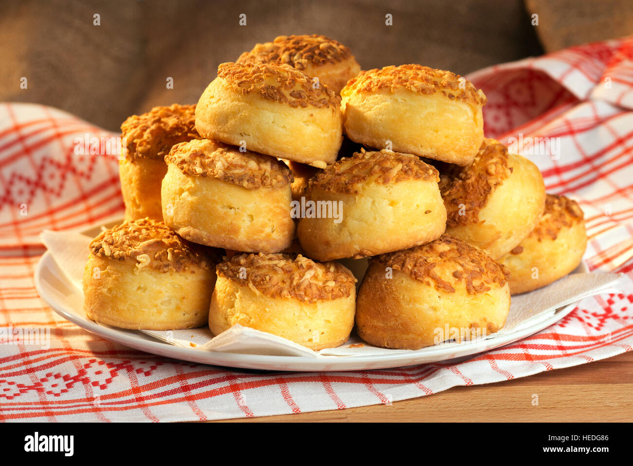 Group of fresh traditional hungarian country food - baked cheese cakes - 'pogácsa' on a plate - Stock Image