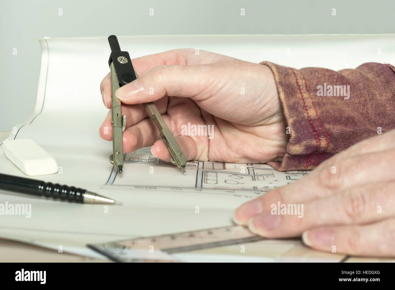 Architect hands holding divider and ruler while working on stock architect hands holding divider and ruler while working on construction engineering project blueprint construction concept malvernweather Image collections
