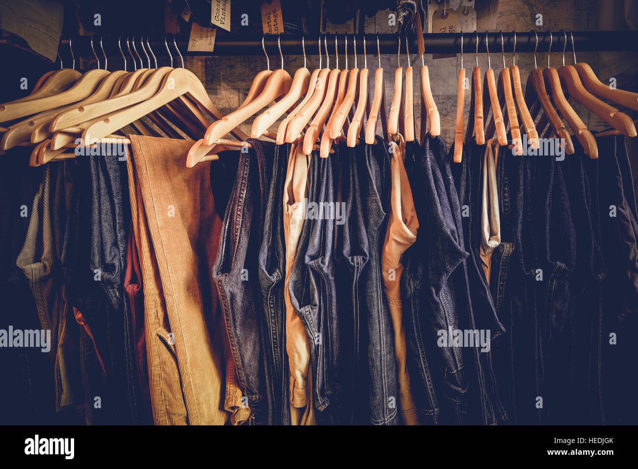 Old denim jeans on sale at Coastal Vintage, retro and vintage clothes shop, Aberystwyth UK - Stock Image