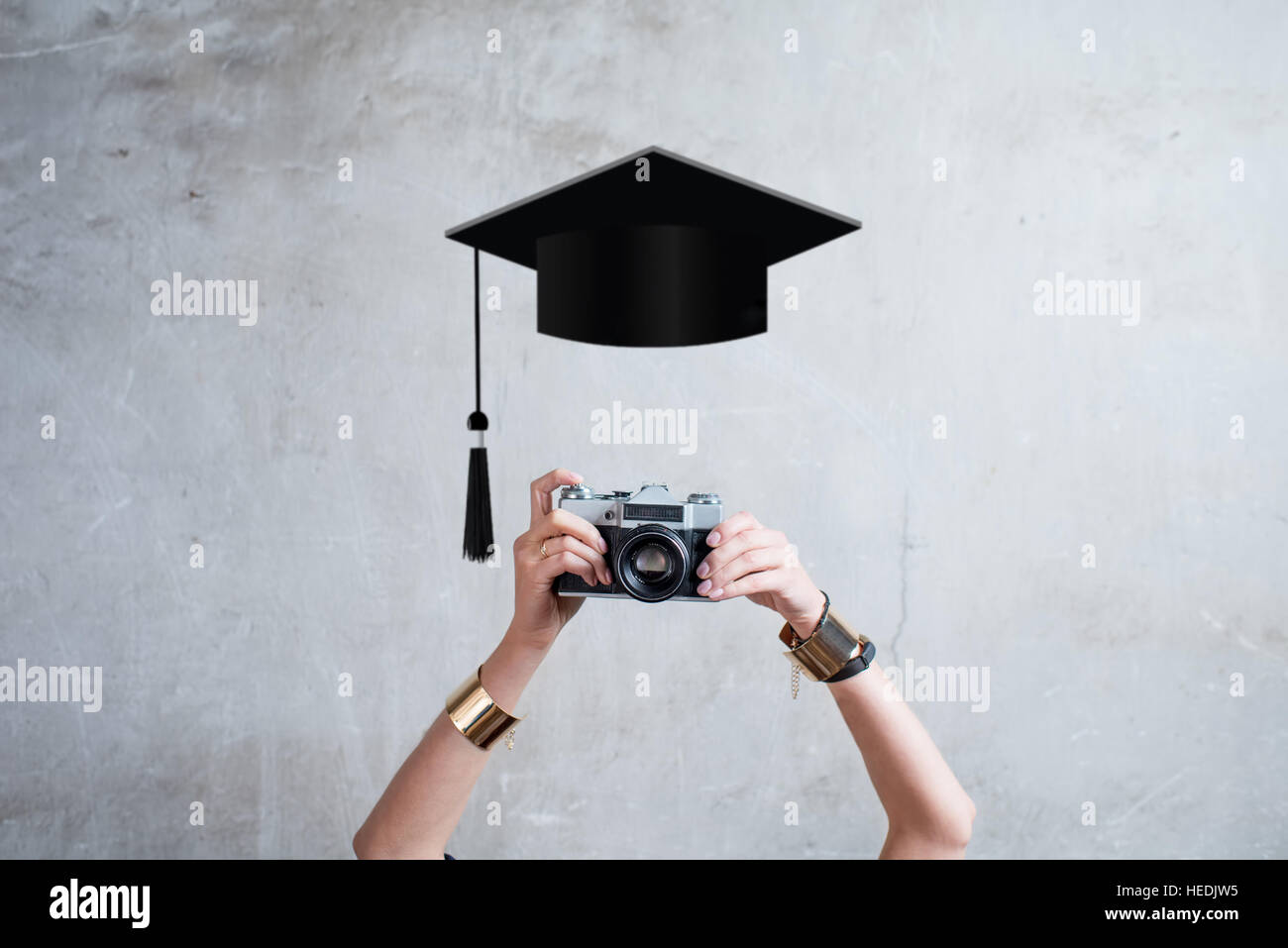 Photo camera on the gray wall background - Stock Image