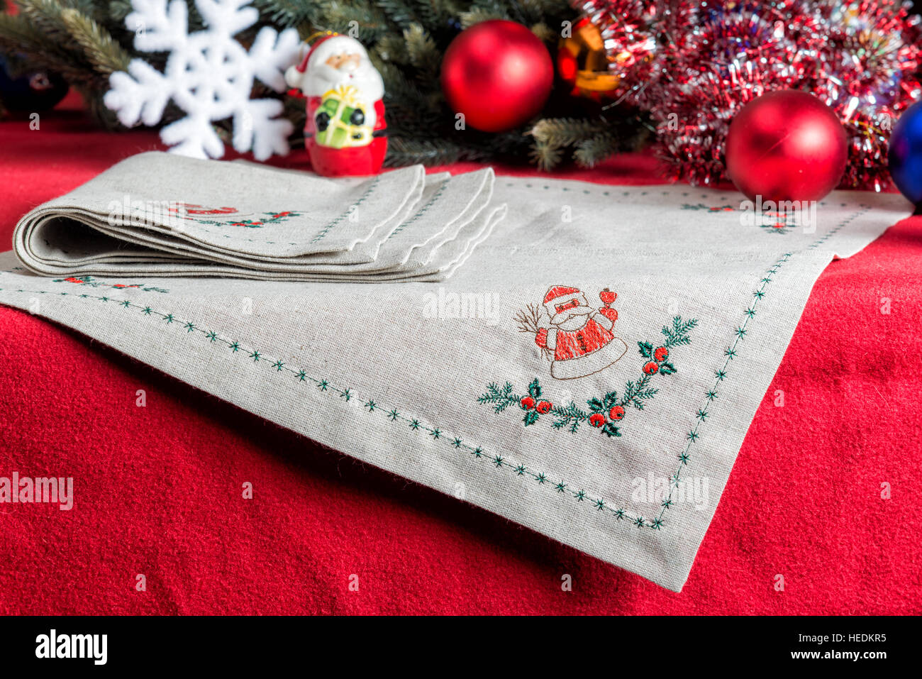 Napkins With Embroidery On The Background Of Christmas Decorations Stock Photo Alamy