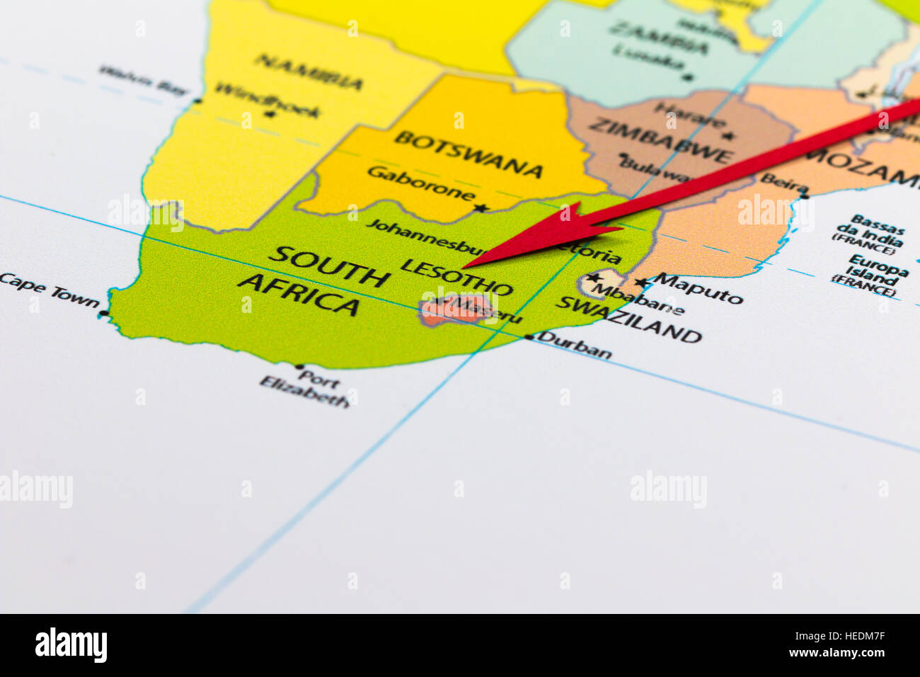 Red Arrow Pointing Lesotho On The Map Of Africa Continent Stock