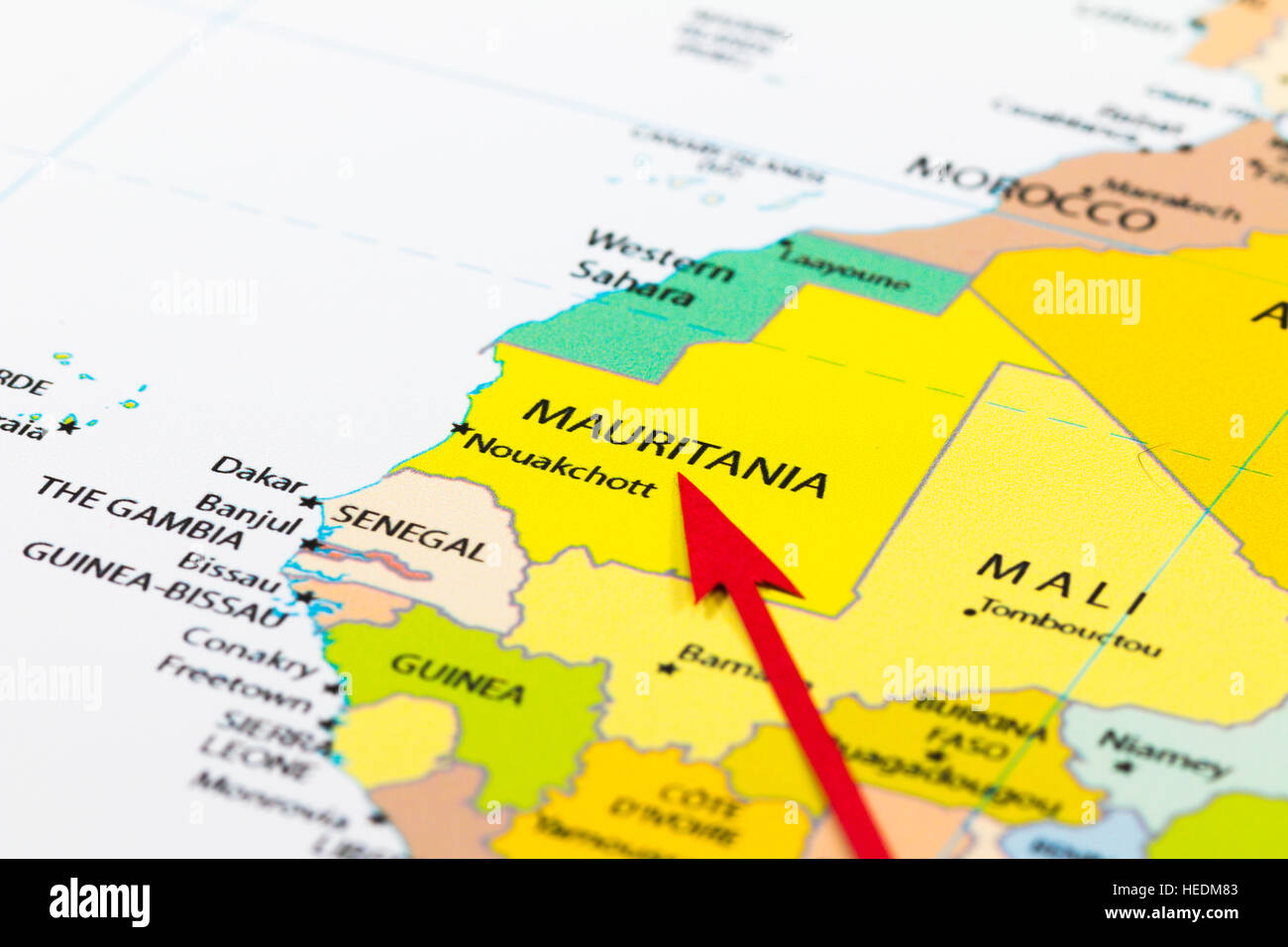 Red arrow pointing Mauritania on the map of Africa continent - Stock Image