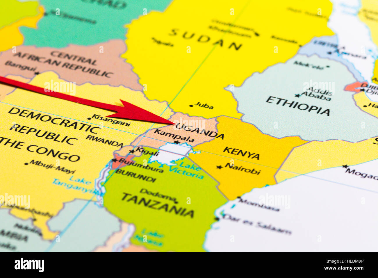 Red arrow pointing Uganda on the map of Africa continent Stock Photo