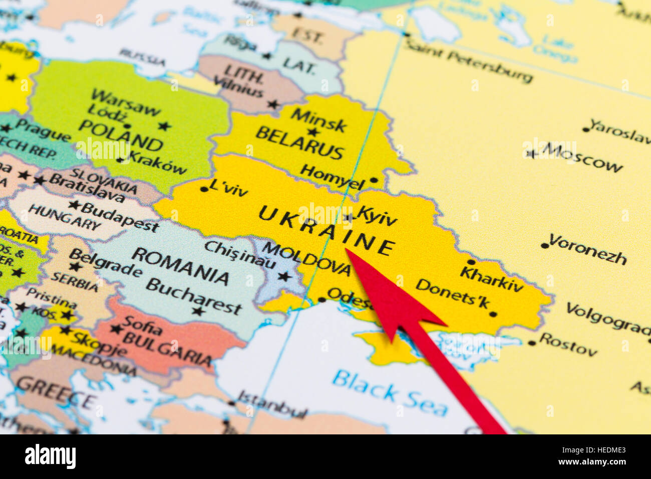 Red arrow pointing Ukraine on the map of Europe continent - Stock Image