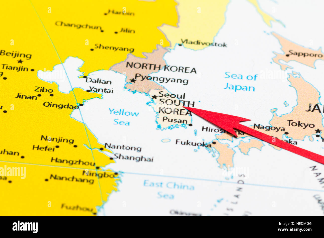 Red arrow pointing South Korea on the map of Asia continent Stock