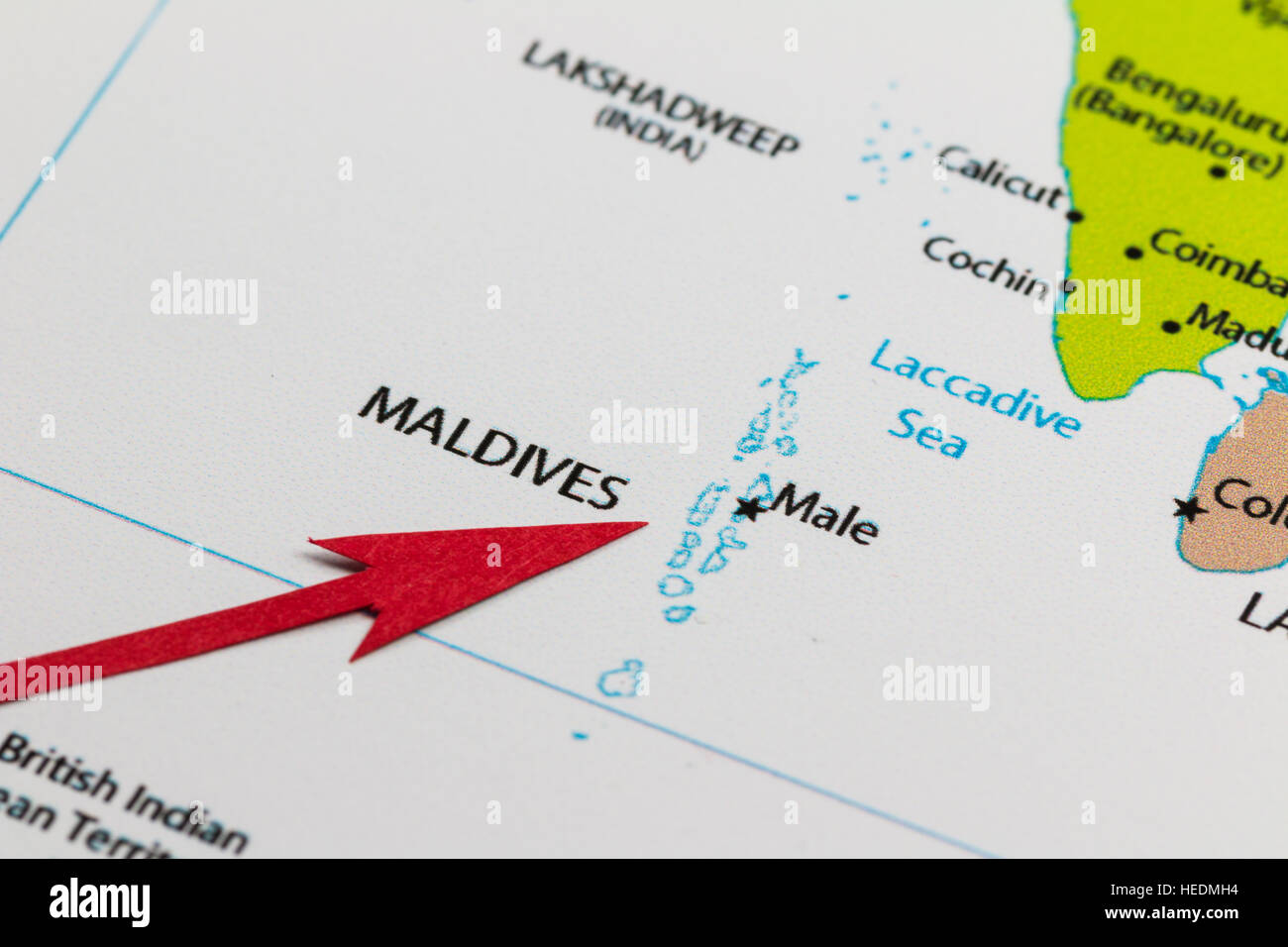 Red arrow pointing Maledives on the map of Asia continent - Stock Image