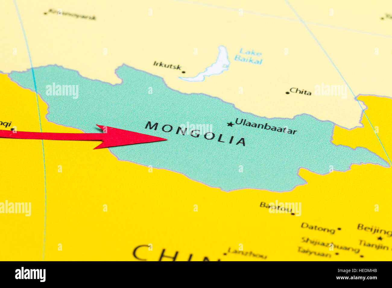 Red arrow pointing Mongolia on the map of Asia continent - Stock Image