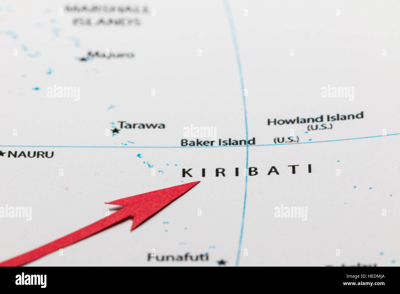 Red arrow pointing Kiribati islands on the map of Pacific ocean - Stock Image