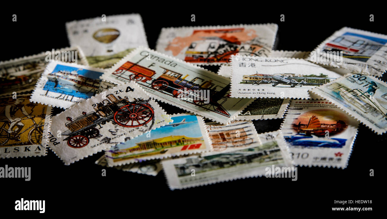 Close up of postage stamps on a black background - Stock Image