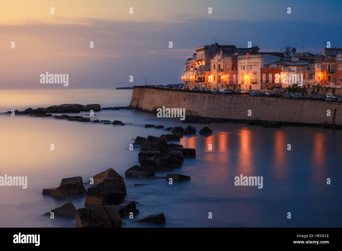 Seafront of Ortygia at dawn, Syracuse, Italy. - Stock Image
