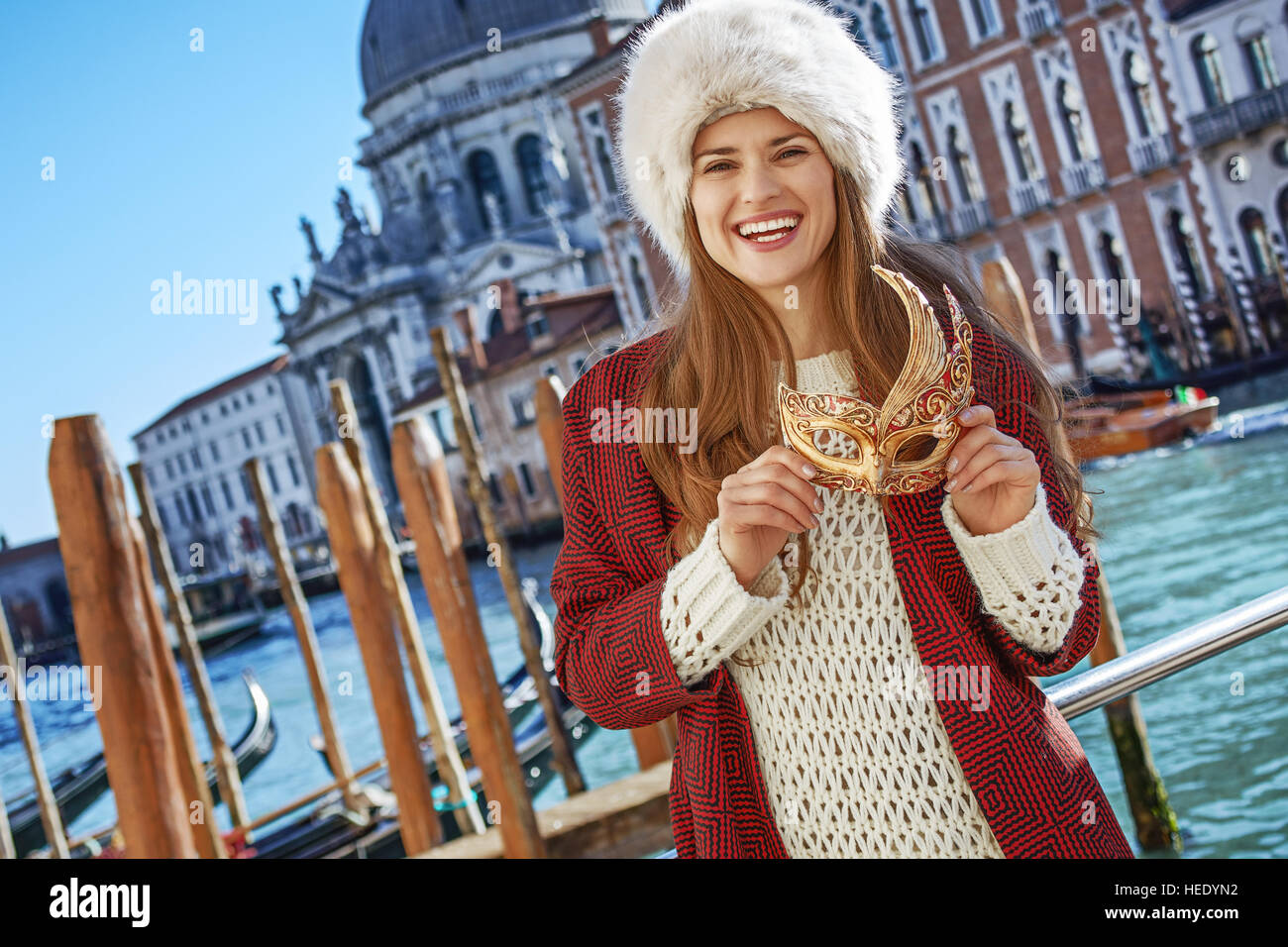 aba1cc0f838 Another world vacation. smiling modern fashion-monger in fur hat in Venice