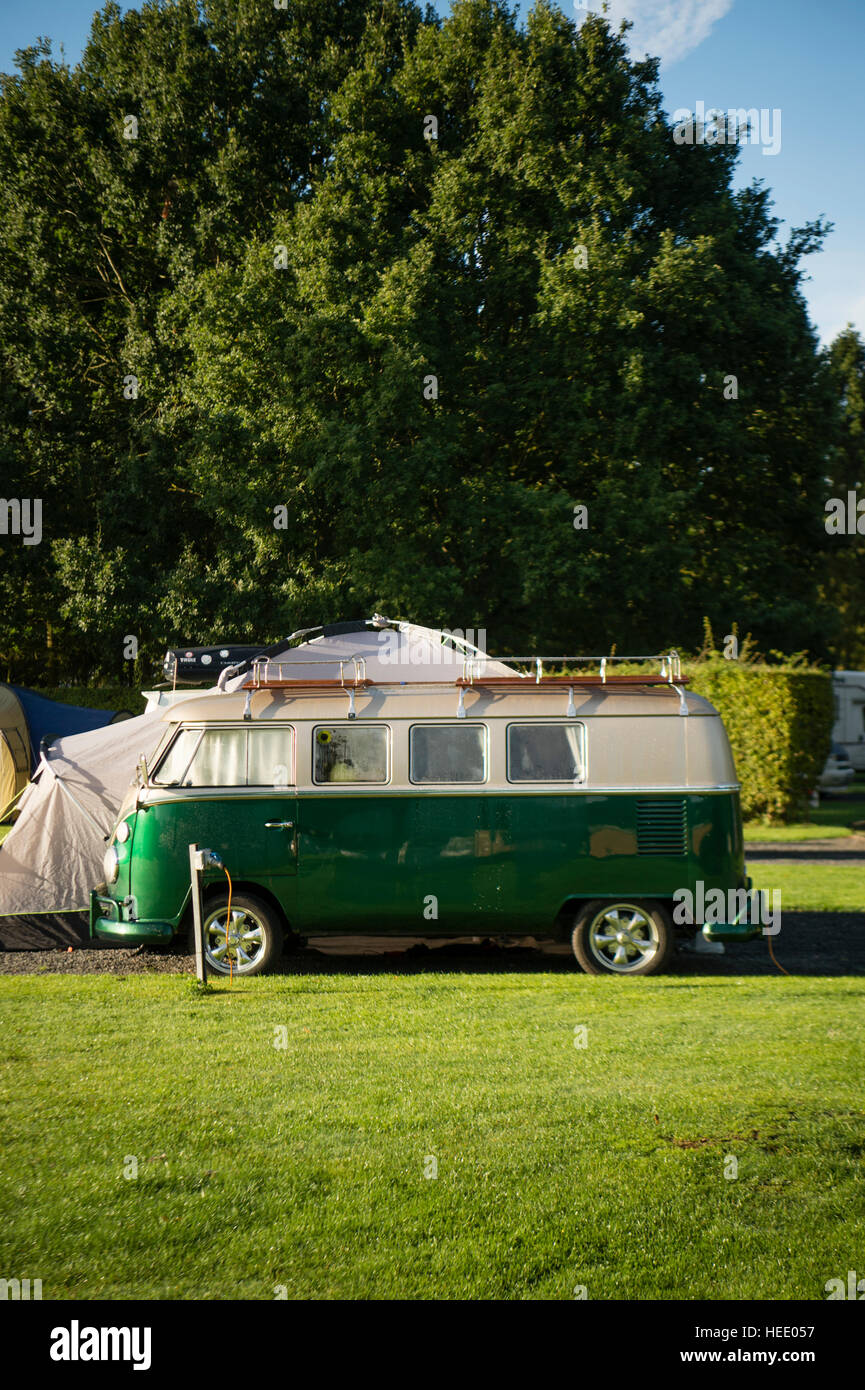 A classic VW Volkswagen campervan T2 motorhome parked up overnight at the Blackmore camping and caravan site, Malvern, - Stock Image