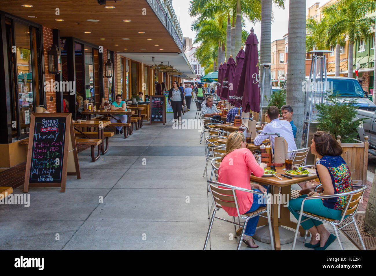 Outdoor dining on sidewalk at restaurant on First Street in Fort Myers Florida - Stock Image