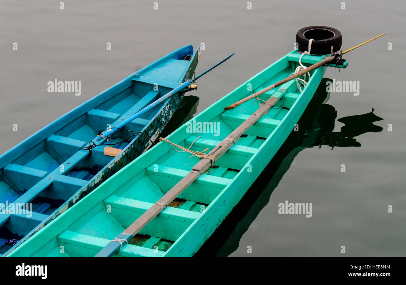 Two row boats floating side by side in water Stock Photo