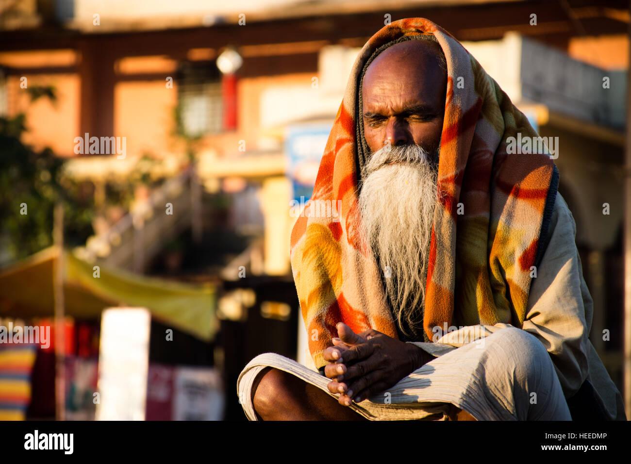 A sadhu doing his morning prayers. - Stock Image