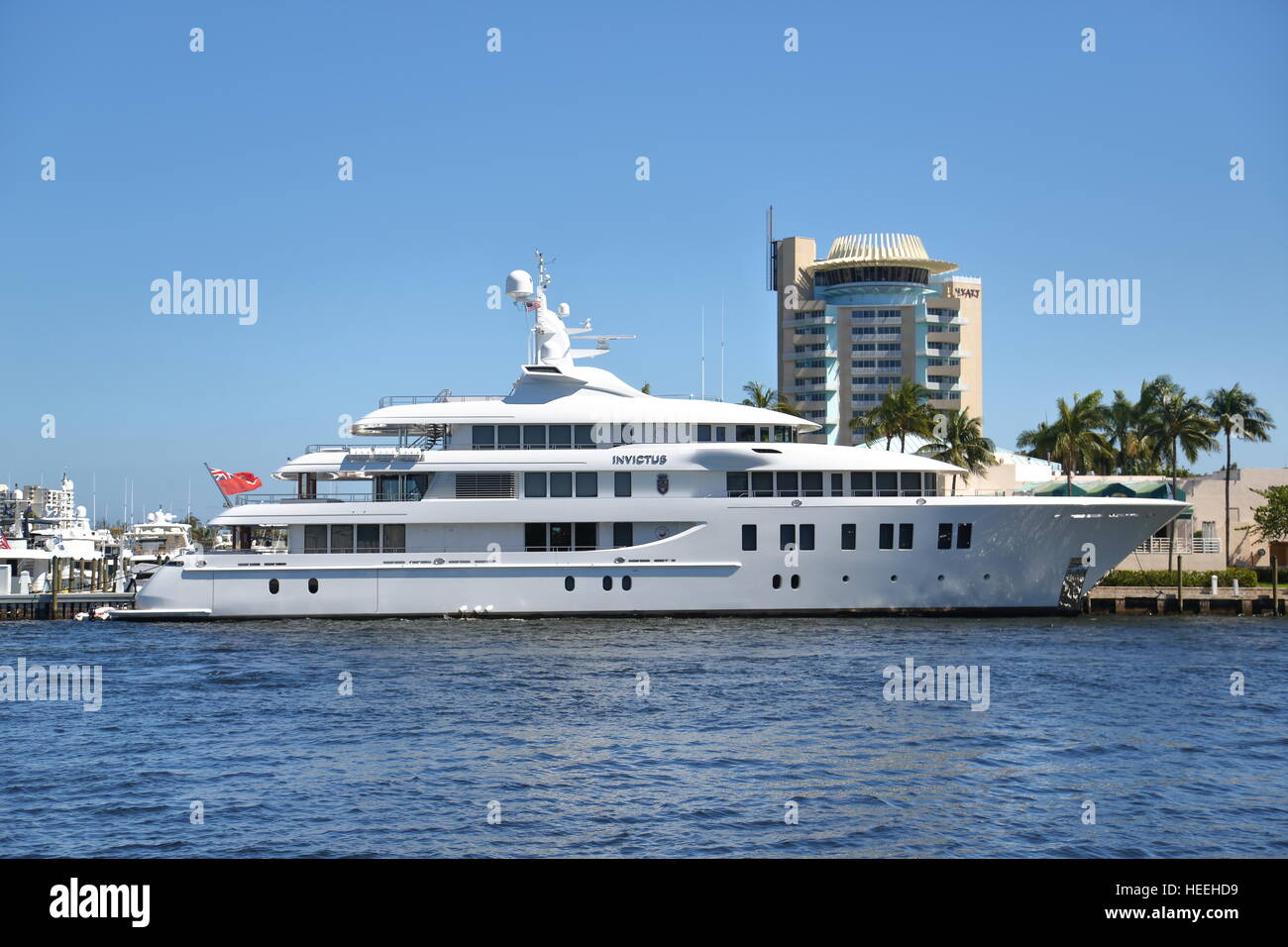 The luxury yacht Invictus moored at Fort Lauderdale, Florida, USA in front of the Hyatt hotel - Stock Image
