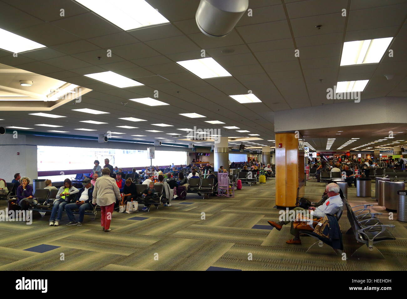 Passengers Waiting For Their Flights Inside The Terminal At Miami Airport Florida USA