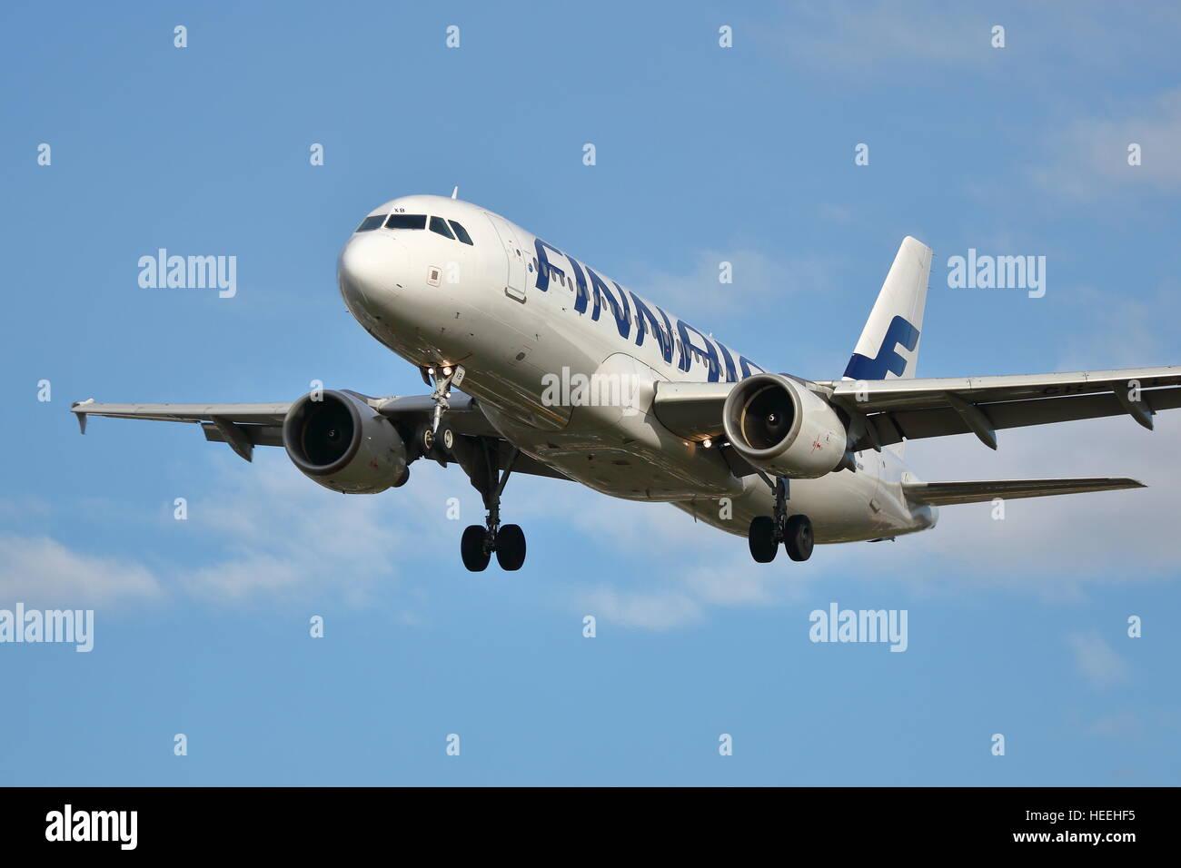 Finnair Airbus A320-200 OH-LXB landing at Heathrow Airport, London - Stock Image