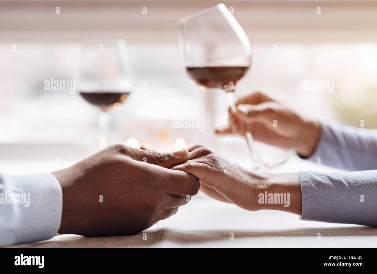 Positive African American couple enjoying the beverage in the restaurant - Stock Image
