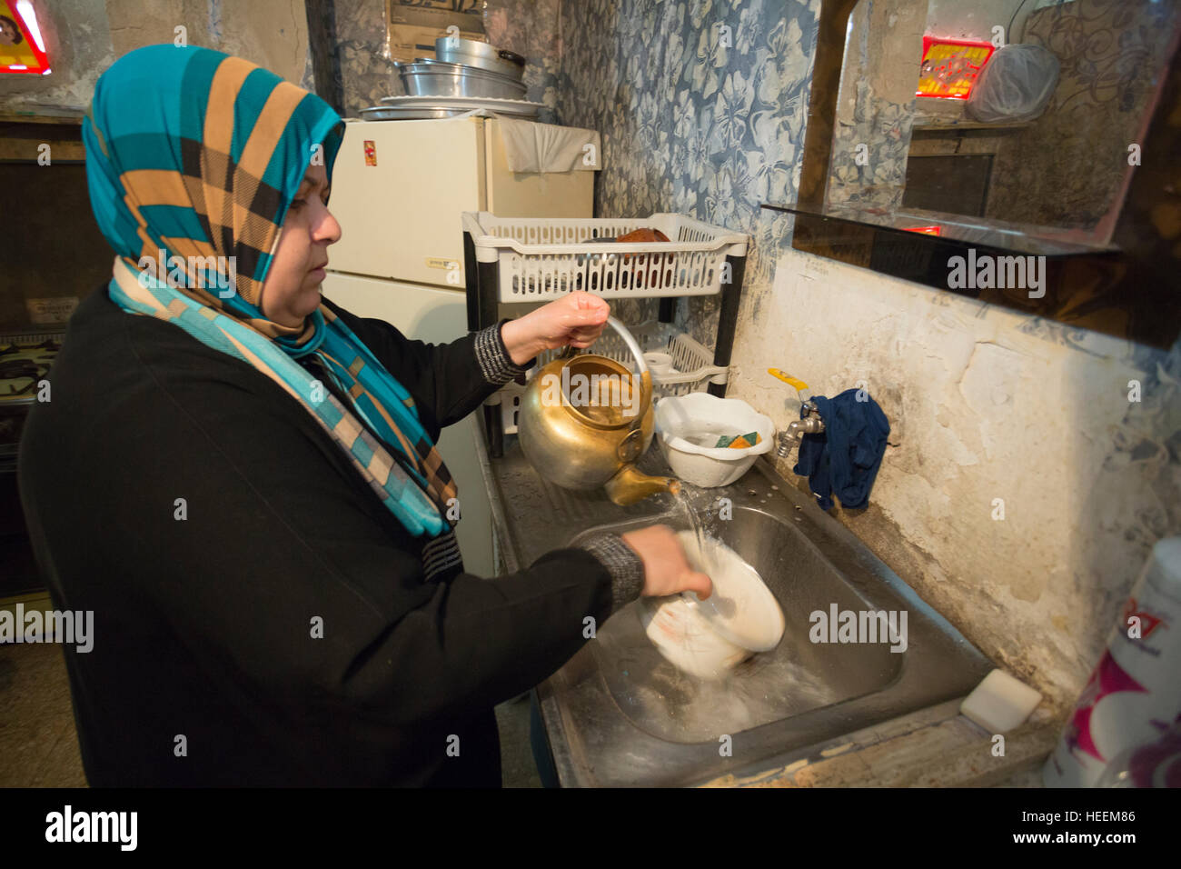 Families struggle to ration drinking water in the city of Zarqa, Jordan. - Stock Image