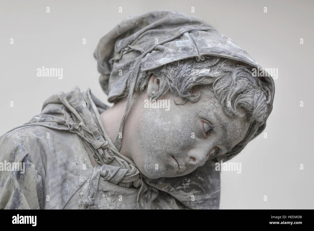 Close-up portrait of a girl performing as a living statue, depicting ''The Little Match Girl'' at - Stock Image