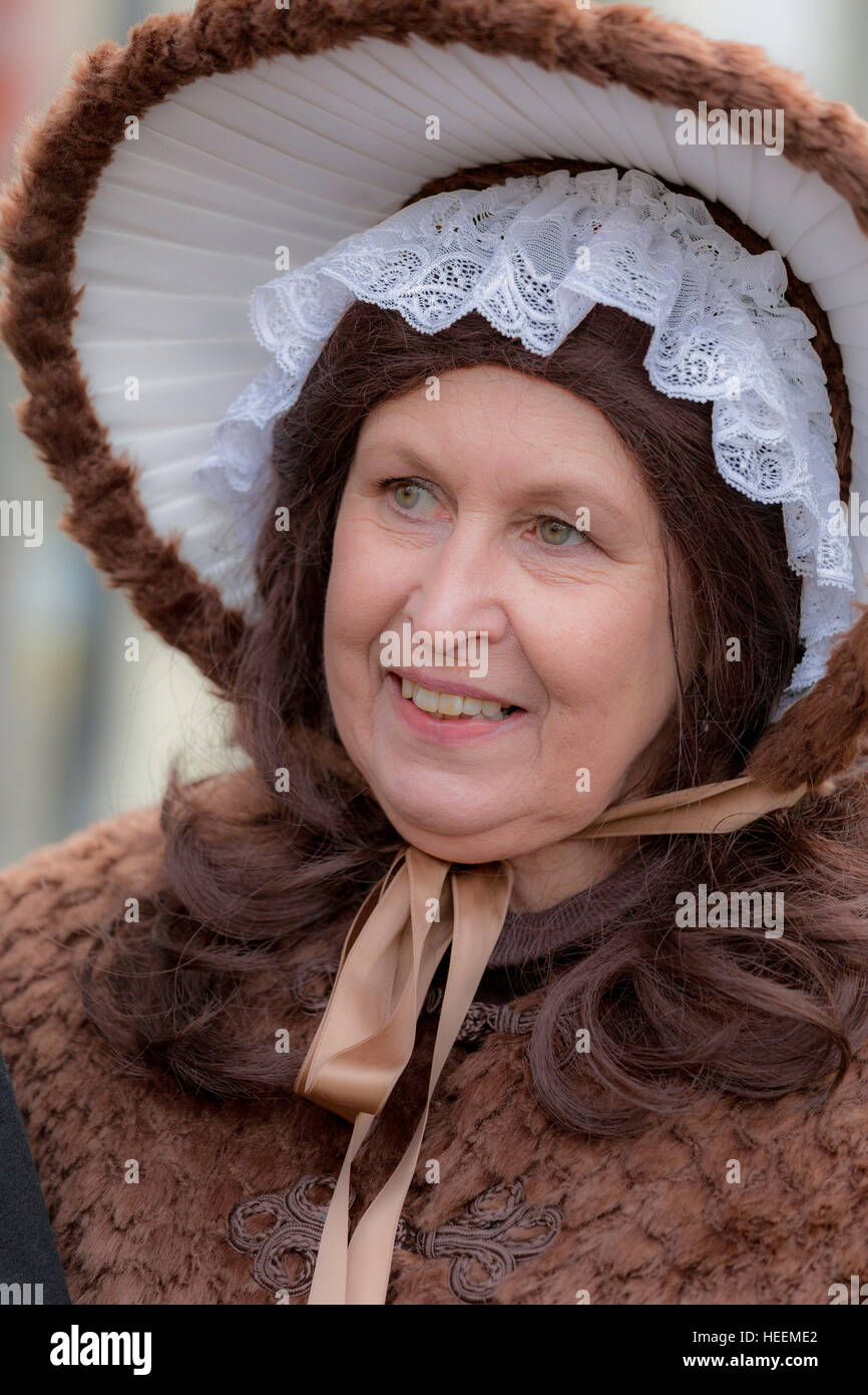 Senior woman dressed in 19th century clothes and hat at the annual Dickens Festival, in Deventer, Overijssel, The - Stock Image