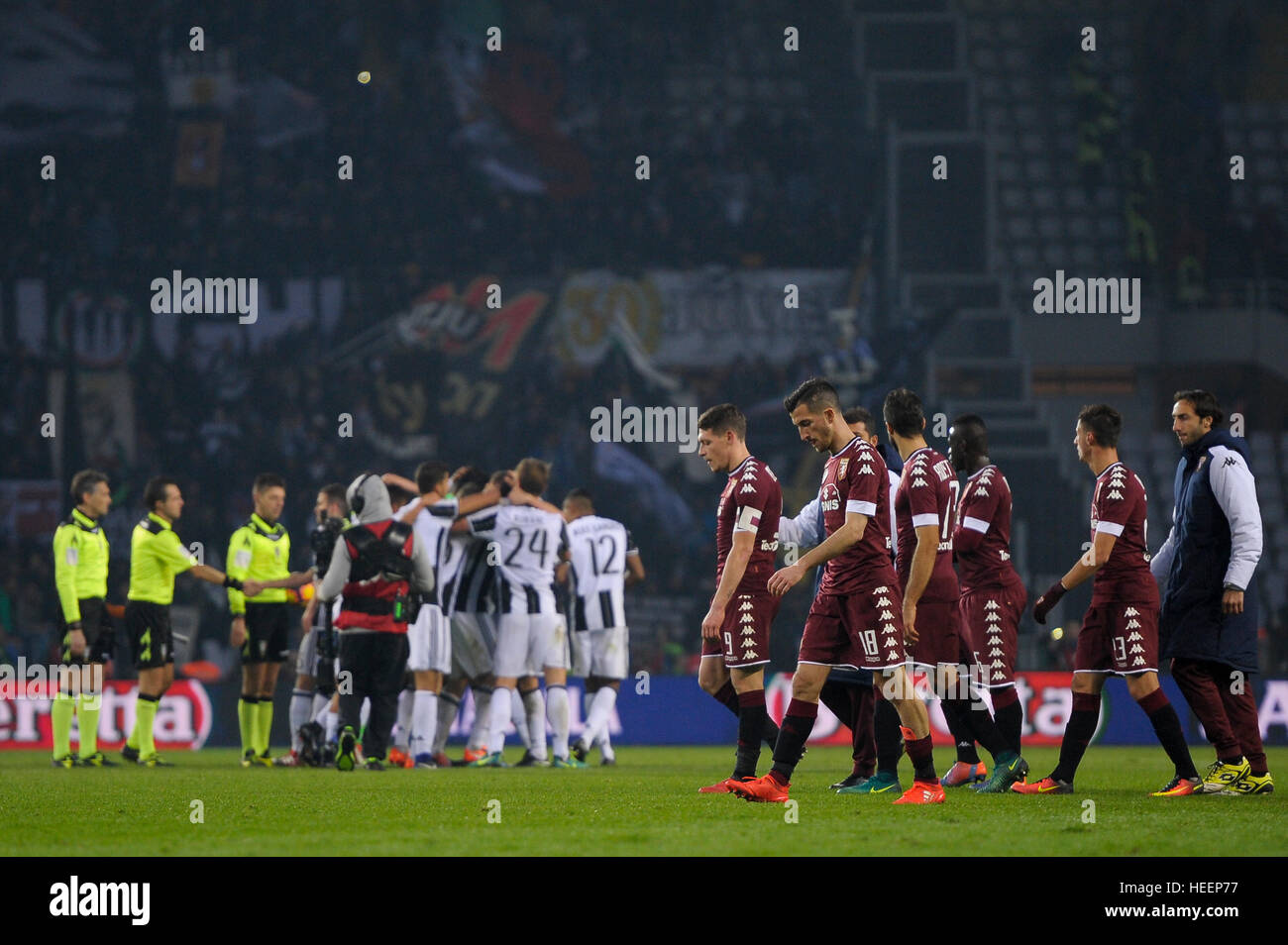 Turin, Italy. 2016, 11 december: Players of Torino FC (right) are disappointed while players of Juventus FC (left) - Stock Image