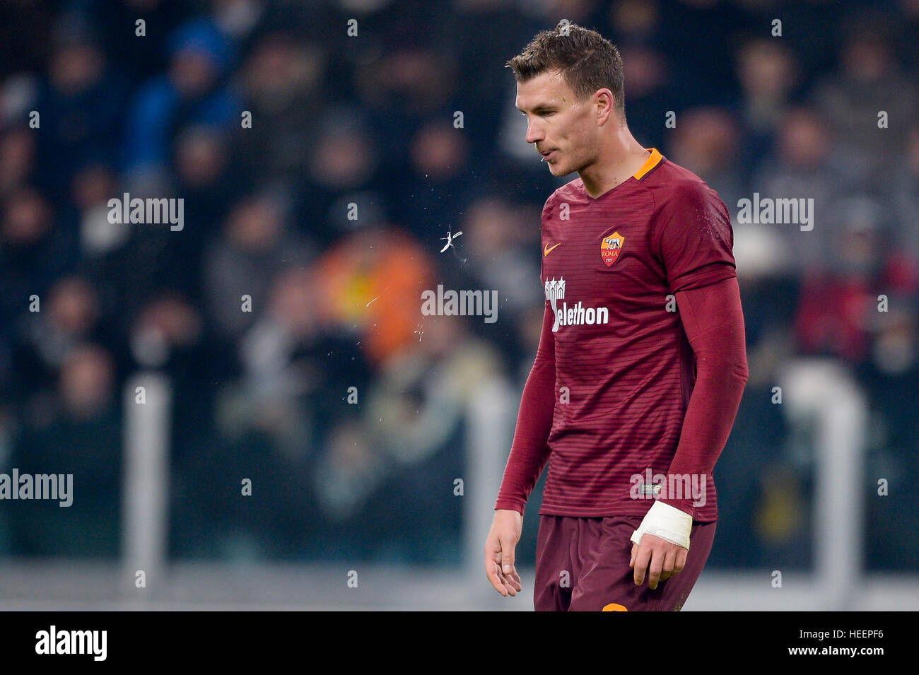 Turin, Italy. 2016, 17 december: Edin Dzeko of AS Roma spits during the Serie A football match between Juventus - Stock Image