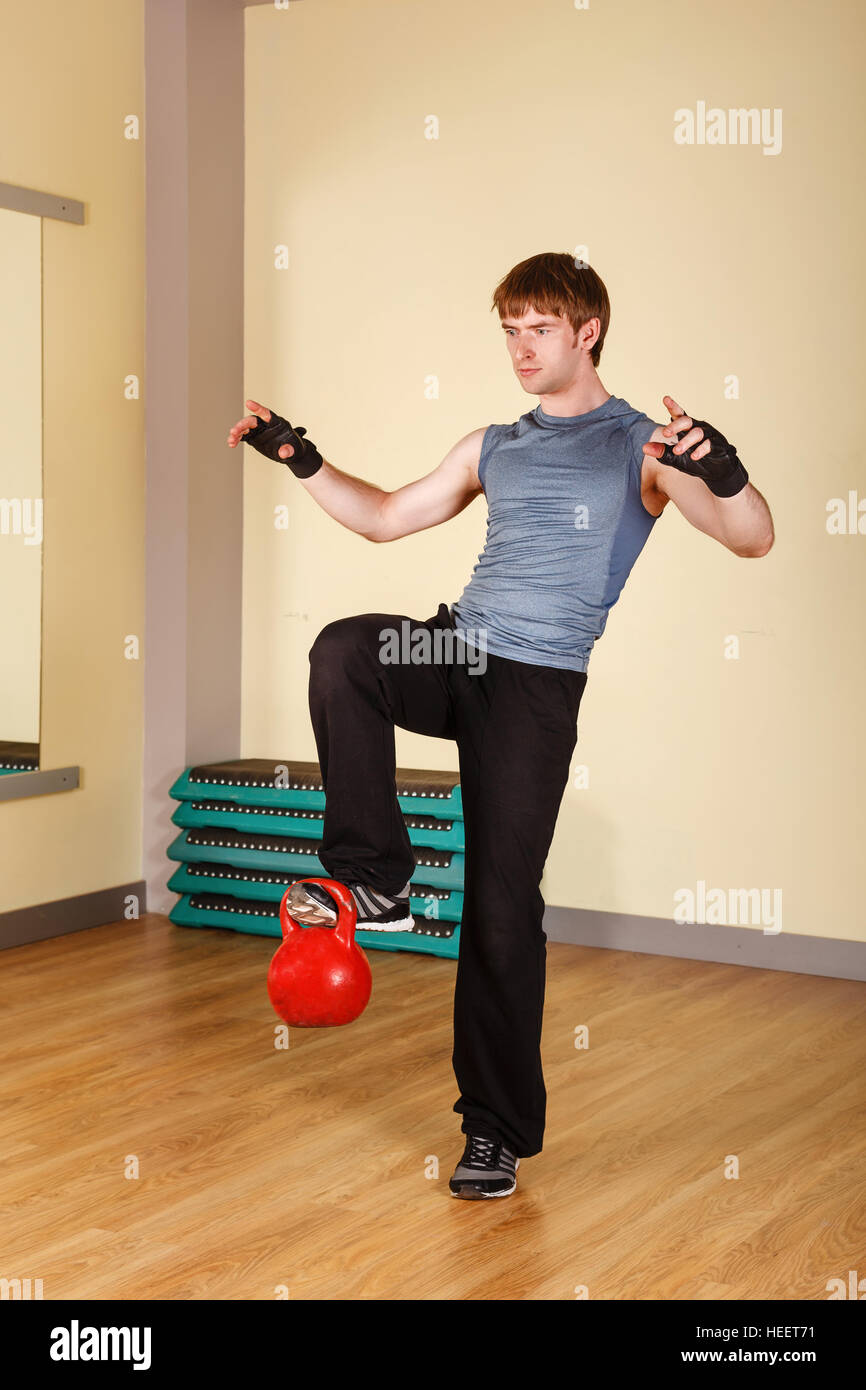 The Man Lifts The Weight On One Foot Train Strength And Balance Healthy Lifestyle Concept Fitness