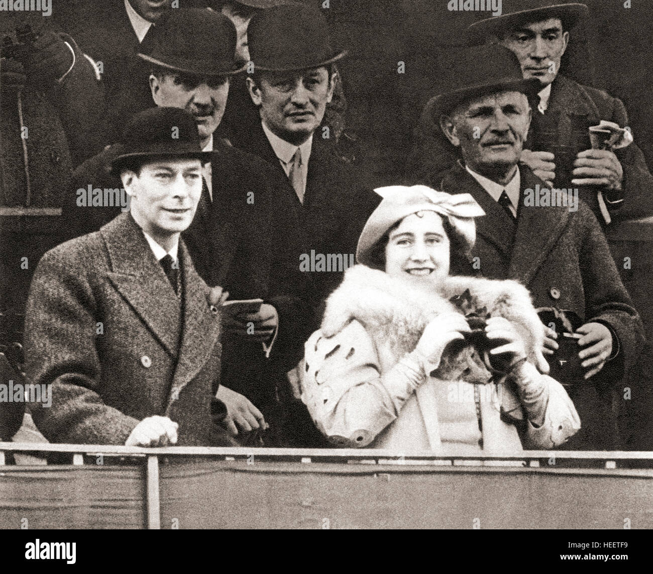King George VI and Queen Elizabeth seen here in the Royal Box at Aintree racecourse for the 1937 Grand National. - Stock Image