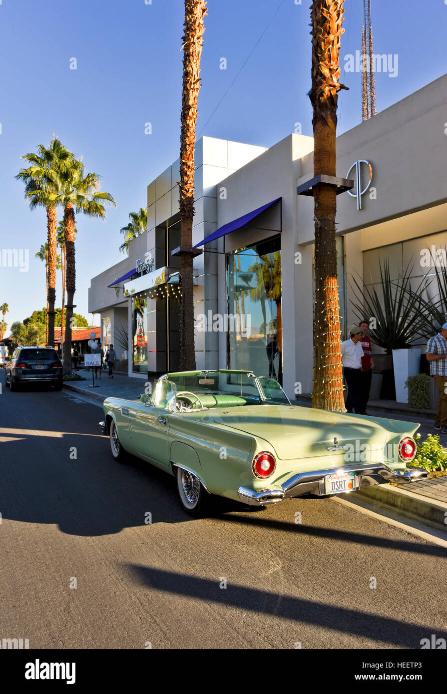 Prestige upscale shopping with a convertible 1960's T-Bird in front of store on El Paseo Drive - Stock Image