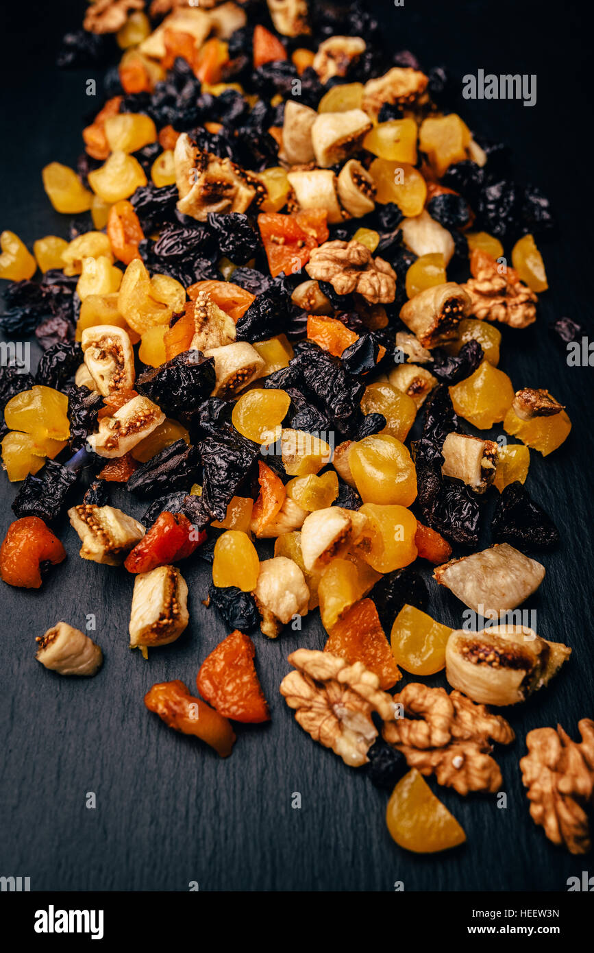 set vegetarian of dried fruit, candied fruit and nuts on a stone table Stock Photo
